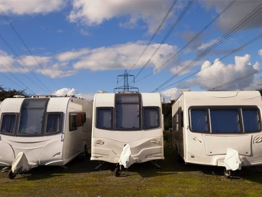 Recreational vehicles lined up in a row.