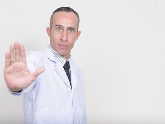 doctor-with-palm-up-indicating-caution_large.jpg