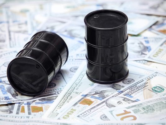 two-oil-barrels-on-top-of-us-currency_large.jpg