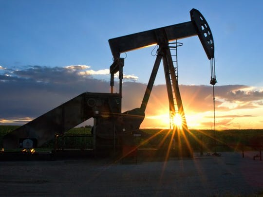 Pump Jack with the sun setting in the background.
