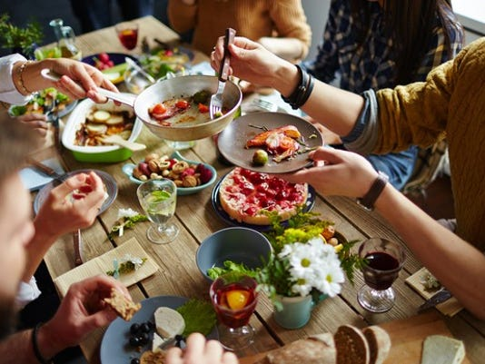 family-dinner-eat-food-restaurant-getty_large.jpg