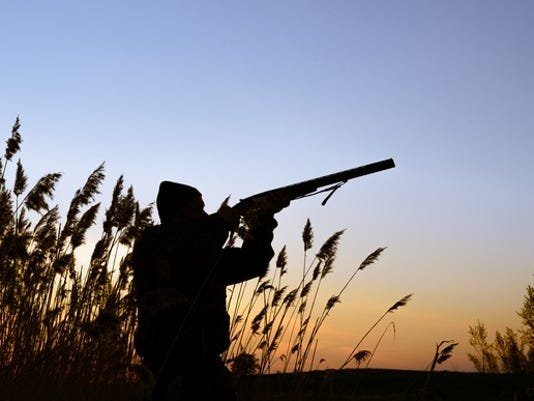 hunter-shooting-at-prey_large.jpg