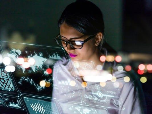 female-engineer-looking-at-data-screens_large.jpg