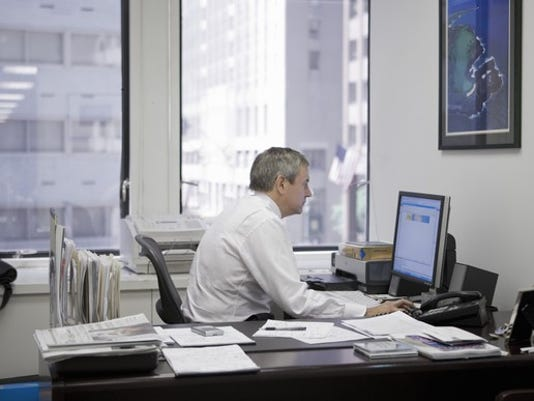 man-working-at-desk_gettyimages-83121902_large.jpg