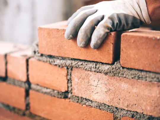 Laying bricks with cement