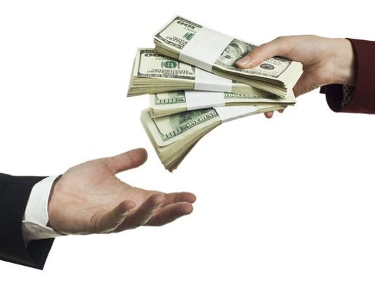 gettyimages-handing-over-lots-of-money_large.jpg