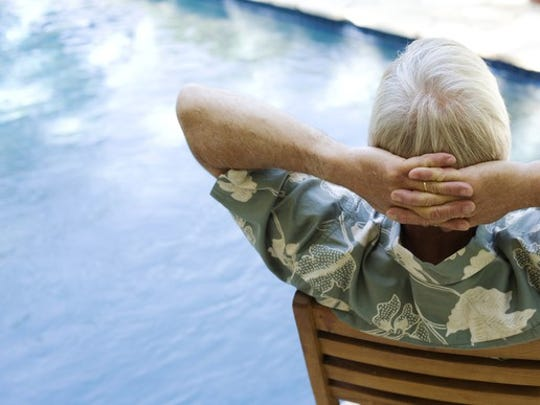 A retiree relaxing by the pool
