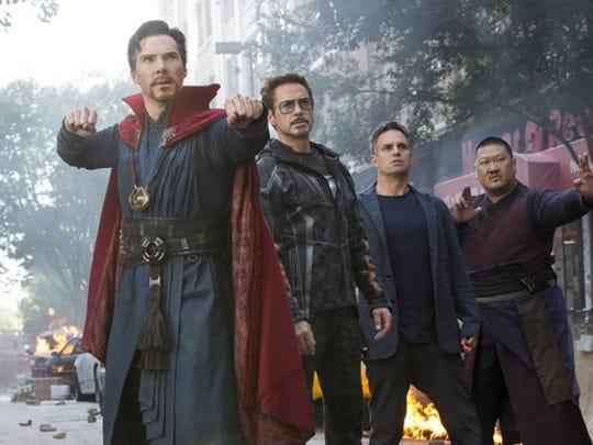 Scene from Avengers: Infinity War showing Dr. Strange, Tony Stark, Bruce Banner, and Wong.