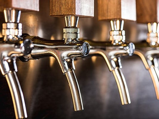 row-of-beer-taps-in-a-pub_large.jpg