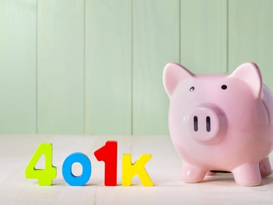 401k spelled out in colorful letters next to piggy bank