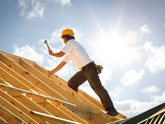construction-worker-hammering-a-roof_large.jpg
