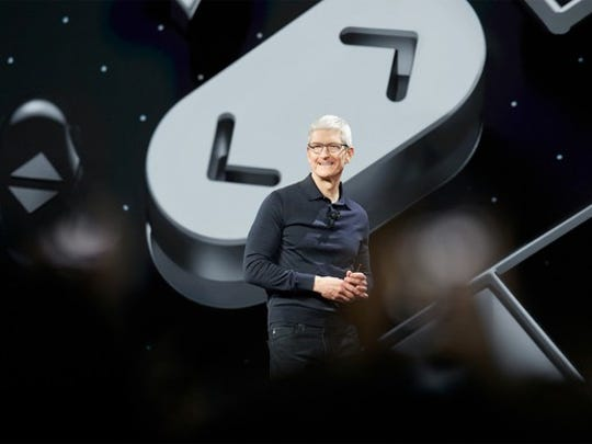 Apple CEO Tim Cook speaking onstage at WWDC 2018
