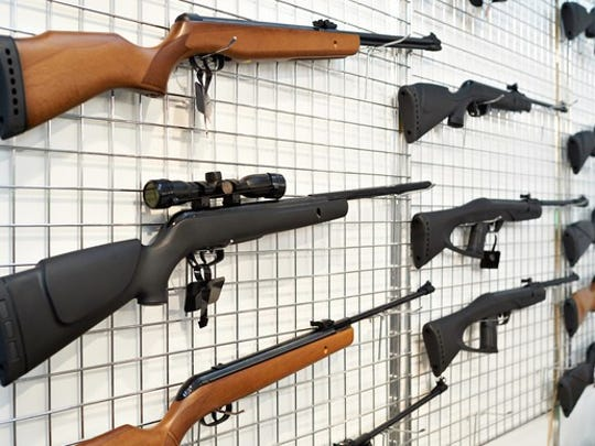 Guns on display at a store.