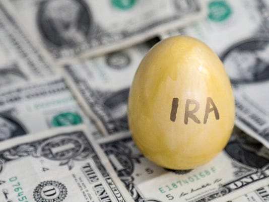ira-golden-egg-on-top-of-money_large.jpg