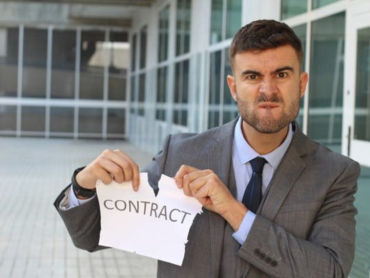 man-ripping-up-a-contract_large.jpg