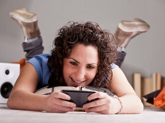 Woman playing games on a cell phone.
