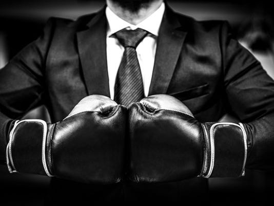 196-business-man-boxing-gloves_large.jpg