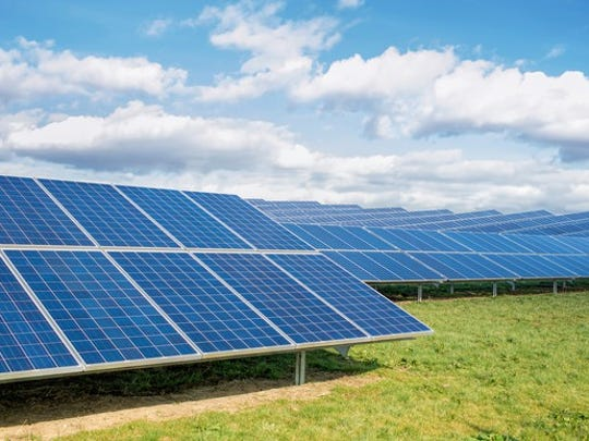 Solar farm in a field.