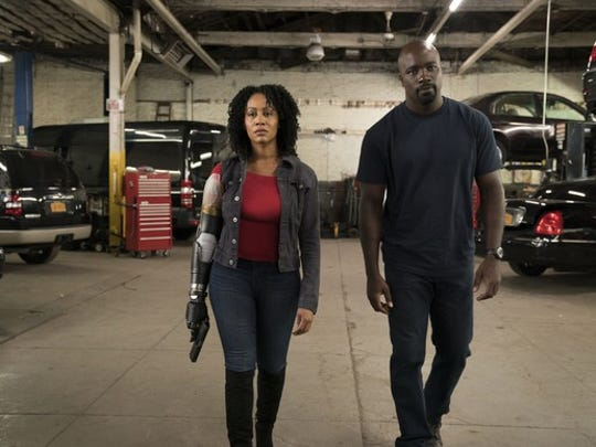 "Simone Missick and Mike Colter as Misty Knight and Luke Cage in ""Luke Cage."""