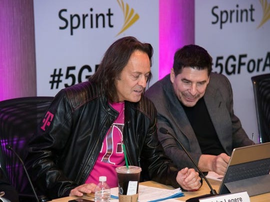 T-Mobile CEO John Legere and Sprint Executive Chairman Marcelo Claure.