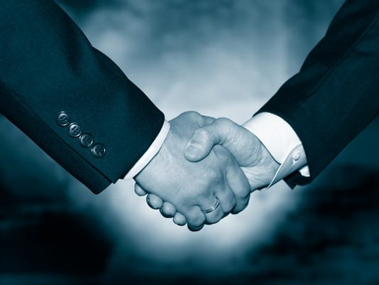 merger-acquisition-handshake-getty_large.jpg