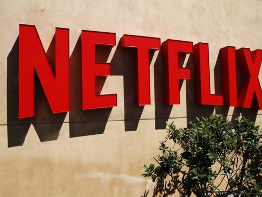 A red Netflix logo on a wall outside the company's headquarters in Los Gatos, California.