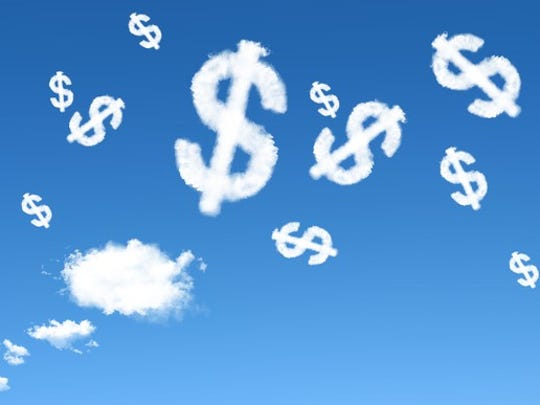 A blue sky is shown, full of clouds in the shape of dollar signs.