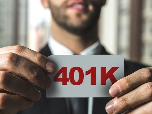 401k-sign_gettyimages-687643306_large.jpg