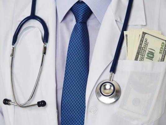 doctor-cash-money-in-pocket-getty_large.jpg