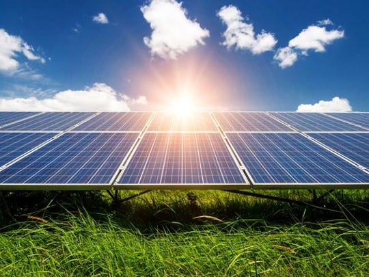 The sun shining on some solar panels.