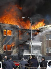 A multi-dwelling fire on Brighton Avenue in Long Branch was complicated by gusting winds, Monday, February 13, 2012
