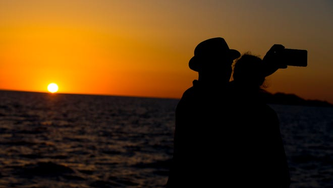 Eco Fun guests watch the sunset during a cruise in Puerto Penasco, Mexico.