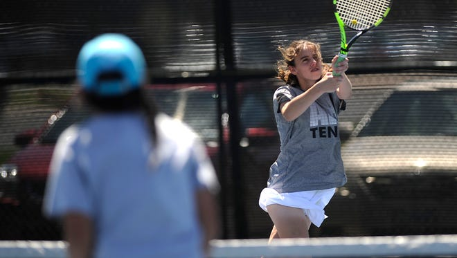 Abilene High's McKenna Bryan returns a ball during her match with partner Lauren Schaeffer in the 2017 Abilene Eagle Invitational tennis tournament on Friday, March 31, 2017, at Abilene High School.