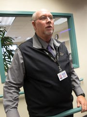 San Juan College High School Principal Don Lorett talks to his students on Dec. 15 at the school in Farmington.