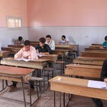 Students take the baccalaureate exam in rebel-held Aleppo, Syria, in August.