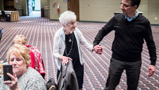 Alberta Green, 90,walks to the stage to receive  her VIVA award from presenter Mark DiFabio during the organization's annual ceremony at the Horizon Convention Center Tuesday.