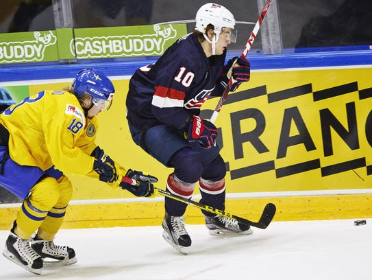 Alexander Nylander of Sweden, left, vies for the puck