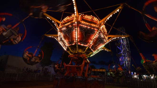 "The ride ""Tornado'' with Ferris wheel in the background on Saturday night at the Door County Fair. To see more photos, go to the gallery under the ""Your Key To The Door Weekly'' tab at www.doorcountyadvocate.com."