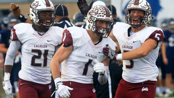 Calallen's John Gaddis (center) and Forrest Crisp (right) celebrate after intercepting the ball against Boerne during the regional semifinals Friday, Nov. 26, 2016, at Farris Stadium in San Antonio.