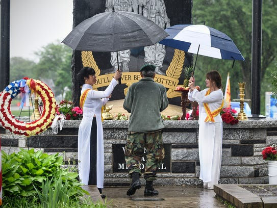 Offerings are offered at the memorial during the Vietnamese