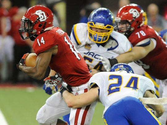 USD's #14 Michael Fredrick drives down the field against SDUS's #24 Nick Farina and #54 Cole Langer during football action at the DakotaDome in Vermillion, S.D., Saturday, Nov. 14, 2015.