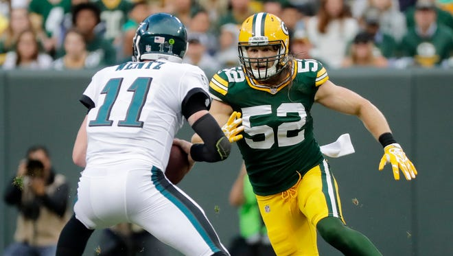 Green Bay Packers outside linebacker Clay Matthews (52) pressures Philadelphia Eagles quarterback Carson Wentz in the first quarter on Thursday, August 10, 2017, at Lambeau Field.