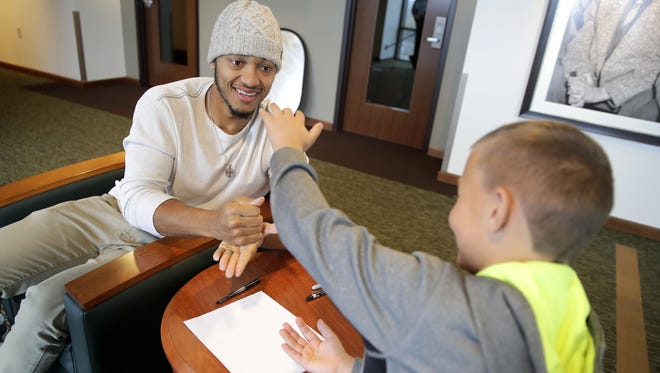 Green Bay's Brett Hundley plays rock, scissors with Reece Killips to decide who gets to ask the first question while chatting before a photoshoot for the Catch a Star Program Tuesday, Nov. 14, 2017, in Green Bay, Wis.  Danny Damiani/USA TODAY NETWORK-Wisconsin