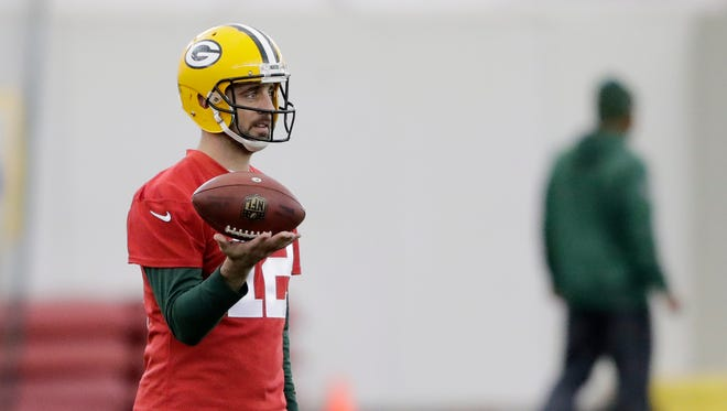 Green Bay Packers quarterback Aaron Rodgers (12) plays with a football during practice at the Don Hutson Center on Wednesday, December 13, 2017 in Ashwaubenon, Wis.