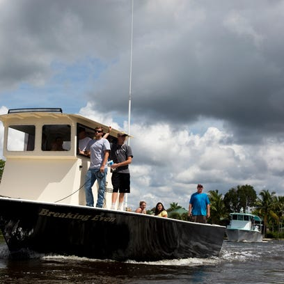 In this file photo, stone crab fisherman approach the
