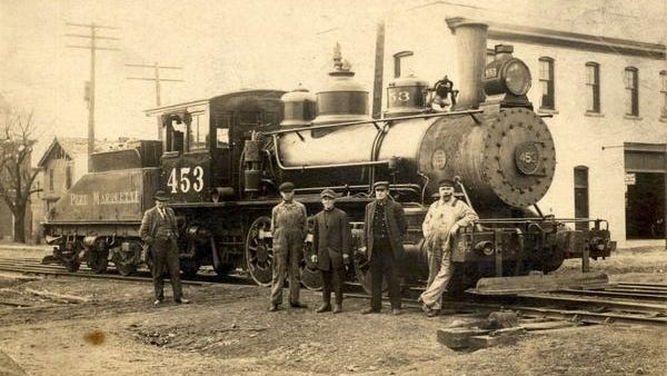 This week's photo from the Ionia County Historical Society archives began as part of the collection at the then Hall-Fowler Library. It shows Pere Marquette engine 453 with five men standing alongside. On the back is written, Apr. 30, 1913. Mills, P. Wieczoreck, CJ Humphrey, S. Truesdale, Fred Williams. Ionia, Mich.