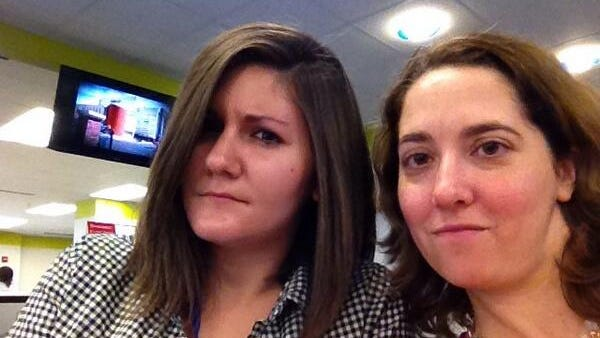 """IndyStar's Courtney Marabella (left) and Cori Faklaris demonstrate their deeply serious expressions that sometimes cause strangers to tell them to """"Smile""""!"""