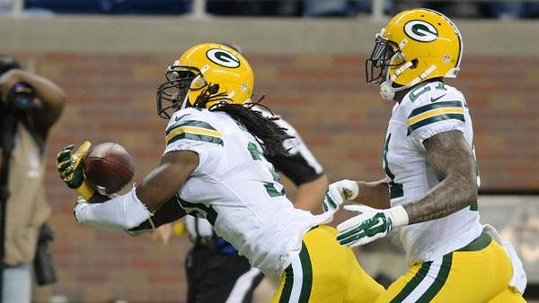 Green Bay Packers cornerback Davon House, left, intercepts a pass against the Detroit Lions during Sunday's game at Ford Field in Detroit.