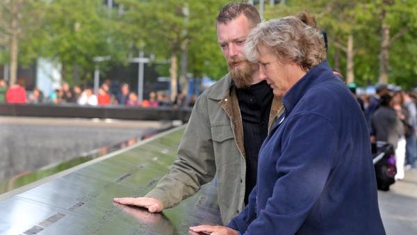 Gail Driscoll Silke of Carmel, and her brother Michael Driscoll of Wappingers Falls, look at the name of their brother, Stephen Patrick Driscoll, engraved along the memorial at one of the two reflecting pools at the World Trade Center site. Stephen Driscoll, who was a Lake Carmel resident and a member of the NYPD Emergency Services Unit, was killed in the attacks of Sept. 11, 2001. His siblings were at the World Trade Center site Sunday to visit the 9/11 Memorial Museum.