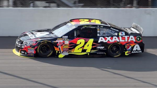 Jeff Gordon qualifies in the final session winning the pole position for the NASCAR Sprint Cup Series auto race at Michigan International Speedway in Brooklyn, Mich.